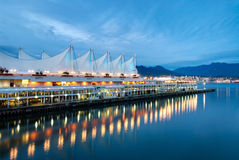 Canada Place at Dusk. Vancouver's Canada Place comes alight at sunset. It is situated on the Burrard Inlet and is home of the Vancouver Convention & Exhibition Royalty Free Stock Images