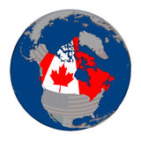 Canada on political globe. Canada with embedded national flag on political globe. 3D illustration isolated on white background Stock Photography