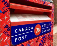 Canada Post. Drop-in post box on a street stock photo