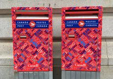 Canada Post mail boxes. On a street stock photo