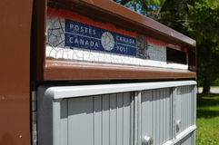 Canada Post Mailbox. Old logo. Street in spring. Old sticker Stock Image