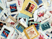 Canada postage stamps. With Canadian flag on Royalty Free Stock Image
