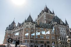 Canada Quebec City 13.09.2017 Chateau Frontenac most famous tourist attraction UNESCO World Heritage Site flags below Royalty Free Stock Image