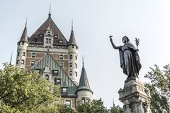 Canada Quebec City Fountain Monument of Faith woman in front of Chateau Frontenac tourist attraction UNESCO Heritage Royalty Free Stock Images