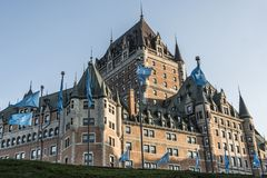 Canada Quebec City Sunset Chateau Frontenac most famous tourist attraction UNESCO World Heritage Site flags circle below Stock Photo