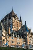 Canada Quebec City Sunset Chateau Frontenac most famous tourist attraction UNESCO World Heritage Site flags circle below Stock Image