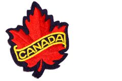 Canada red maple leaf emblem. Made of embroidery cloth, isolated on white background Stock Image