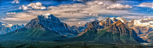 Canada Rocky Mountains Panorama landscape view. Canada Rocky Mountains Panorama on cloudy sky banff park