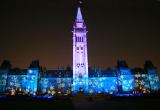 Canada's Floodlit Parliament. The Canadian Parliament and Peace Tower are floodlit during their nightly sound and light show in Ottawa royalty free stock photo