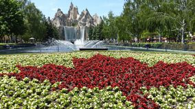 Canada's Wonderland. The biggest entertainment park in Ontario, on a summer day, the flag of Canada is always displayed at the entrance Stock Photo
