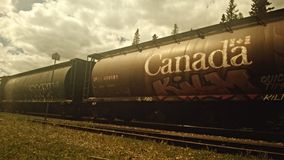 Canada on side of railroad car. Desaturated railroad car on track with Canada in block letters Royalty Free Stock Photo