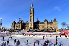 Canada 150 skating rink on Parliament Hill. Ottawa, Canada - December 11, 2017:  The temporary skating rink erected on Parliament Hill as part of the Canadian Royalty Free Stock Photography