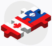 Canada and Slovenia Flags in puzzle isolated on white background Royalty Free Stock Image