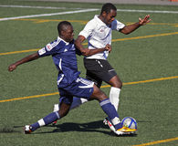 Canada soccer ball ontario quebec. Keishon Alcindor of the Ajax Strikers from Ontario and Michael Mutunda of St-Hubert, Que., battle for the ball in the gold stock images