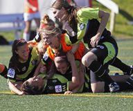Canada soccer quebec women win celebration. Players from Longueuil, Que., celebrate their gold-medal game win against the North London Galaxy from Ontario at the stock photography
