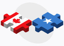Canada and Somalia Flags in puzzle isolated on white background Royalty Free Stock Images