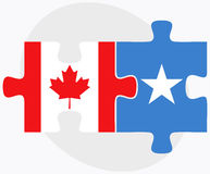 Canada and Somalia Flags in puzzle isolated on white background Royalty Free Stock Photos