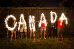Canada sparklers in time lapse photography. The word Canada in sparklers in time lapse photography as part of Canada Day (July 1) celebration Stock Photography