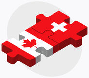 Canada and Switzerland Flags in puzzle isolated on white background Royalty Free Stock Photo