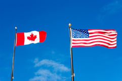 Canada and USA flags Royalty Free Stock Images