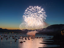 Canada, Vancouver - Annual Celebration of Light Fireworks Show Over the Marina. The fireworks in show hundreds of feet in the air make the boats around them stock image