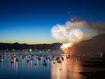 Canada, Vancouver - Annual Celebration of Light Fireworks Show Over the Marina. The fireworks in show hundreds of feet in the air make the boats around them stock photo