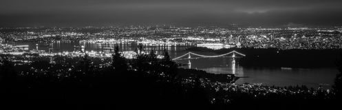 Canada, Vancouver - Panorama from Cypress Mountain Showing Lions Gate Bridge. Lions Gate bridge is one of the more famous bridge in Vancouver, leading to Stanley royalty free stock photography