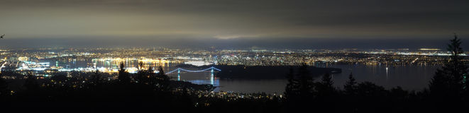 Canada, Vancouver - Panorama from Cypress Mountain Showing Lions Gate Bridge. Lions Gate bridge is one of the more famous bridge in Vancouver, leading to Stanley royalty free stock images