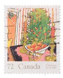 CANADA - VERS 1987 : un timbre imprimé dans les expositions Mistlet photographie stock libre de droits