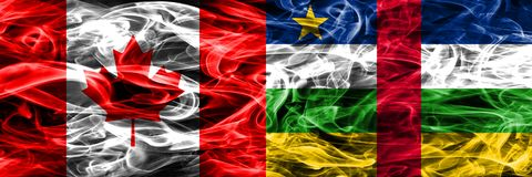 Canada vs Central African Republic smoke flags placed side by si. De. Canadian and Central African Republic flag together royalty free stock image