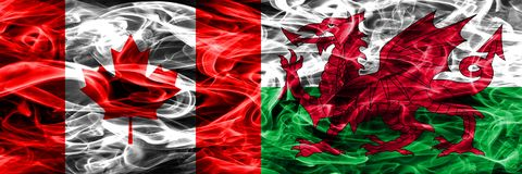 Canada vs Wales smoke flags placed side by side. Canadian and Wa. Les flag together royalty free illustration