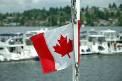 Canada in the Wind. Canadian Flag in the wind at the Opening Day Parade Royalty Free Stock Images
