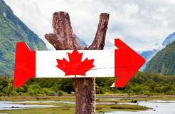 Canada wooden sign with mountains background Stock Image
