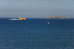 Canadair. Baiona, Spain - July 15, 2008: Seaplane picking up water from the sea on the Galician coast during summer fire season 2008 Stock Photography