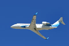 The Canadair Bombardier CRJ-200 plane in the sky of Siberia Stock Photos
