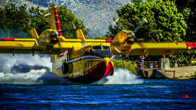 Canadair Cl-415. Scooping water at river Neretva Stock Photo
