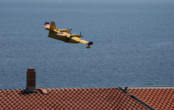 Canadair Low Above The Roofs Stock Image