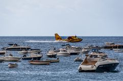 Canadair refilling water royalty free stock photography