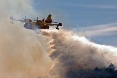 Canadair in water and smoke. Canadair fire fighting airplane in France Stock Photography
