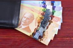 Canadees geld in de zwarte portefeuille royalty-vrije stock foto
