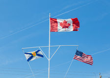 Canadees, Nova Scotia en Amerikaanse Vlaggen Stock Foto's