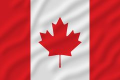 Canadese vlag met een pottenblad in het midden stock foto