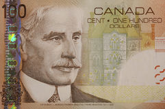Canadian 100 dollar bill. Top corner of a Canadian 100 dollar bill