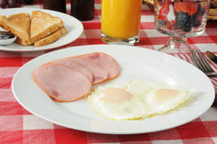 Canadian bacon breakfast with fruit cocktail royalty free stock images