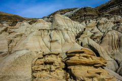 Canadian badlands in late spring, Drunheller, Alberta, Canada. Scarred badland in the Canadian desert located in drumheller alberta Royalty Free Stock Photography