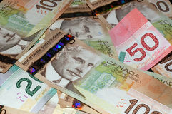 Canadian Bills ($20, $50, $100). An image of Canadian bills with various denominations ($20, $50, and $100 royalty free stock image