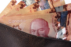 Canadian bills on wallet Stock Photos