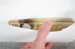 Canadian 100 bills in white envelope Royalty Free Stock Images