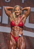 Canadian Bodybuilder Flexes Bigtime in Toronto. Canadian bodybuilder Maria Mikola  flexes awesome biceps and displays fierce abs and quadriceps as she earns 2nd Royalty Free Stock Photo