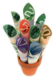Canadian Cash. Rolled up Canadian cash in a terra cotta pot stock photography
